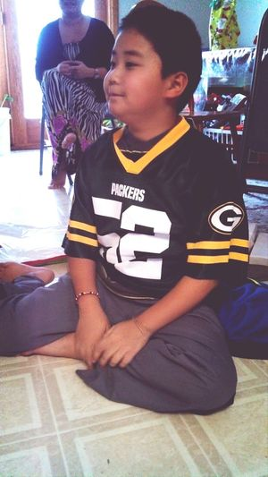 Meng with his Packers jersey he got from Grandma!