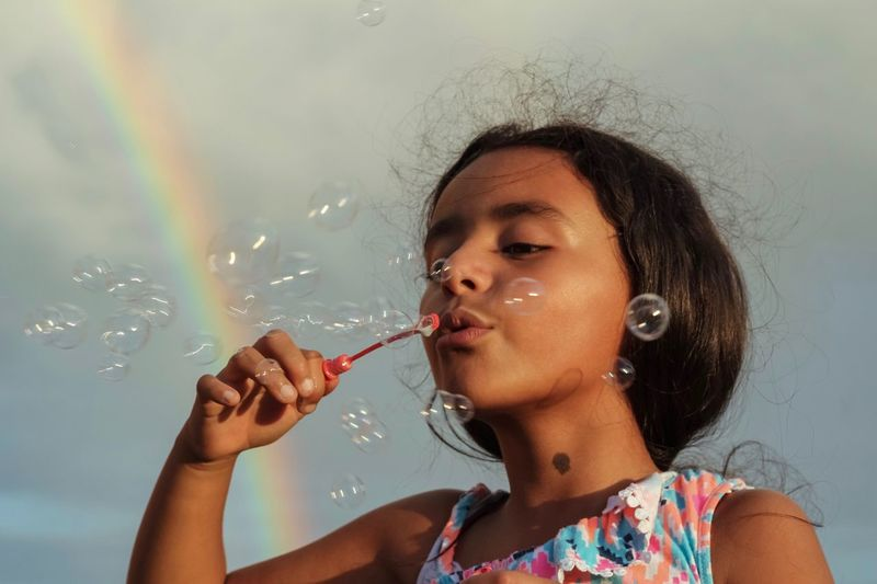Fun Spring Blowing Bubbles Girl Outdoors Childhood Colorful Rainbow Headshot Portrait Real People Leisure Activity One Person Lifestyles Bubble Holding Blowing Day Capture Tomorrow Moments Of Happiness 2018 In One Photograph My Best Photo 17.62°