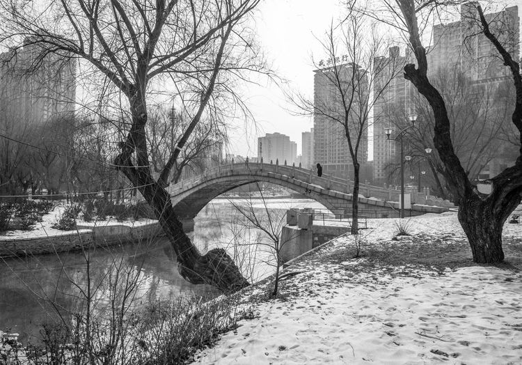 Bridge over river during winter