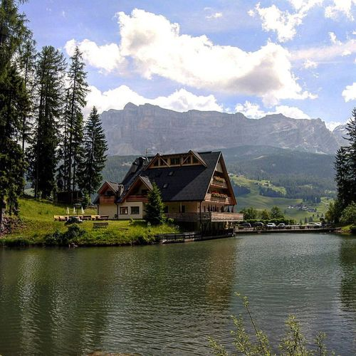 dolomiti Alta Badia Architecture Beauty In Nature Boathouse Built Structure Day Dolomiti Italy House Lake Landscape Mill Nature No People Outdoors Reflection Scenics Sky Tree Water Waterfront Watermill