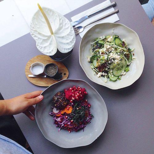High Angle View Of Various Salad Bowls On Table