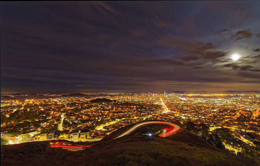 Moon rise @ Twin Peaks. Pentax PENTAX K-1 Pentax 15-30 F/2.8 Wide Angle Long Exposure San Francisco California Bay Area USA Starburst Car Trails Hill Cloud - Sky Low Light High Angle View Curve Aerial View Beauty In Nature City Cityscape Illuminated Night No People Outdoors Scenics Sunset California Dreamin