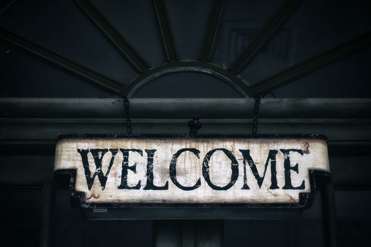 Low angle view of a welcome sign