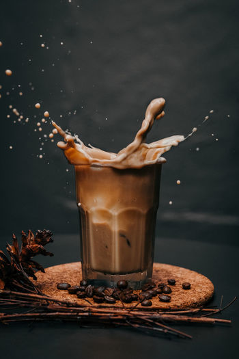 chocolate and coffee Splashing Droplet Black Background Drink Drinking Glass Motion Liquid Shaking Milk Brown Coffee - Drink Roasted Coffee Bean Caffeine High-speed Photography