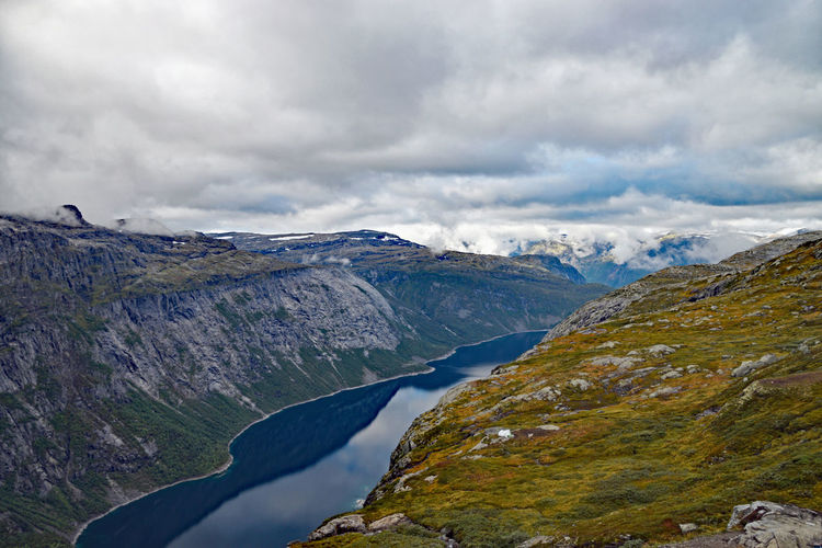 View along Trolltunga hike Norway Beauty In Nature Cloud - Sky Day Environment Land Landscape Mountain Mountain Peak Mountain Range Nature No People Non-urban Scene Outdoors Overcast Rock Scenics - Nature Sky Tranquil Scene Tranquility Trolltunga Norway Hiking Water