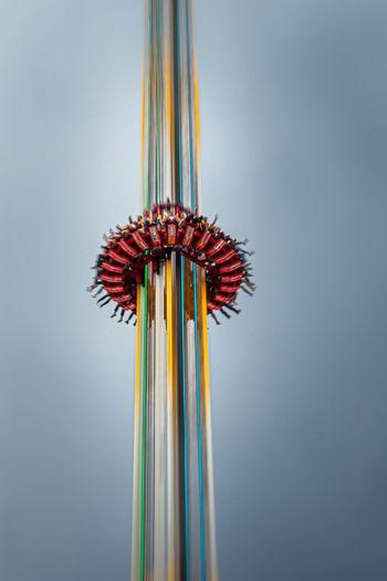 Close-up of multi colored umbrella against sky