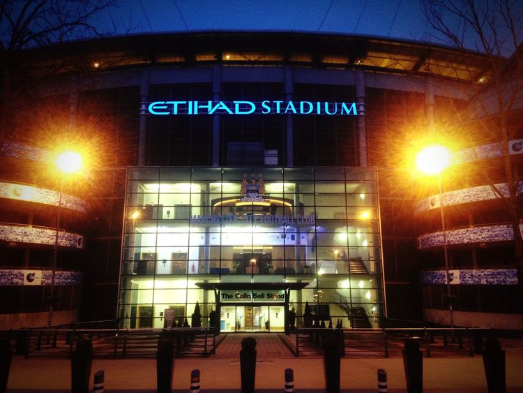 Etihad Stadium, MCFC Text Architecture Night Built Structure Communication Low Angle View Outdoors No People City Clock