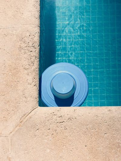 Minimal Blue Water Swimming Pool Pool Geometric Shape No People Circle High Angle View Shape Day Outdoors Nature Poolside Sunlight Absence Flooring Design Pattern Tube Concrete