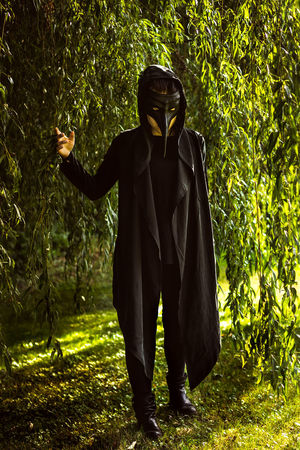 Shooting Girl Woman Model Mask Plague Plague Doctor Coat Black Light And Shadow Nature Plants Portrait Mood Color Germany Deutschland Creativity Female Green Color Grass Day Showcase October Standing Mask - Disguise