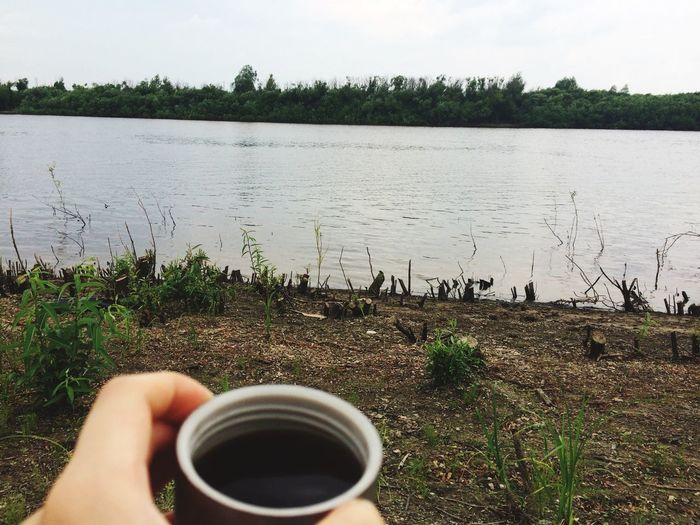 🌿 Nature + coffee = amazing pastime Space To Breathe Amaturephotography Cup Human Hand One Person Drink Hand Mug Real People Refreshment Plant Food And Drink Holding Lifestyles Human Body Part Unrecognizable Person Nature Leisure Activity Day Outdoors Coffee Water 10