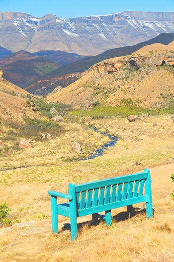 Empty bench in a field