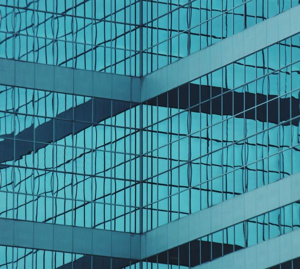 The Architect - 2017 EyeEm Awards Architecture Built Structure Glass - Material Building Exterior Modern Full Frame Reflection No People Window Day Pattern Backgrounds Outdoors Blue Sky Close-up The Graphic City