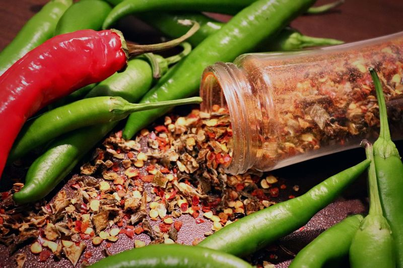 Hot moment in kitchen 🔥🌶 Food And Drink Vegetable Food Pepper Chili Pepper Spice Freshness Healthy Eating Wellbeing Close-up Still Life High Angle View Red Green Color Green Chili Pepper No People Red Chili Pepper Ingredient Chili  Indoors