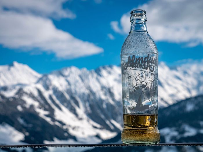 EyeEm Selects Cloud - Sky Bottle Container Nature Water Refreshment Close-up Drink Food And Drink Focus On Foreground No People Glass - Material Outdoors Freshness Table Sky Glass