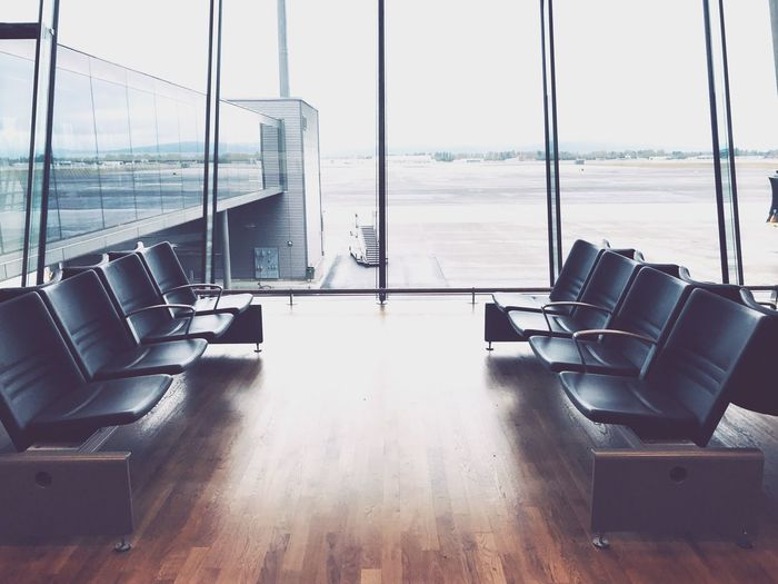 Waiting hall Window Sea Indoors  Chair Travel Luxury Colour Your Horizn Airport Departure Area No People Airport Transportation Seat Sliding Door Modern Airplane Scenics