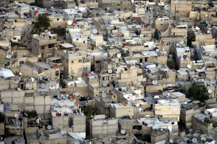 Full frame shot of buildings with satellite dishes on terraces