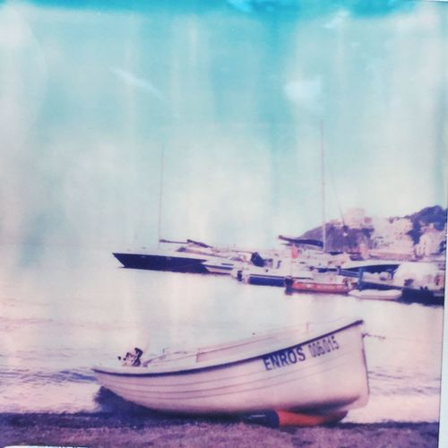 Summer Vintage Nautical Vessel Transportation Boat Sky Water Sea Tranquil Scene Outdoors Polaroid Impossible Project Tourism Italy The Week Of Eyeem Memories Classic Minimalism Analogue Photography EyeEm Italy The City Light