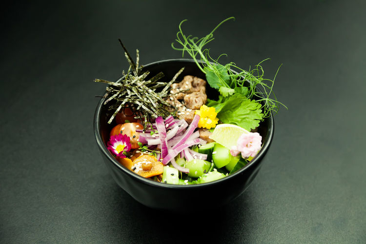Close-up of chopped vegetables in bowl on table