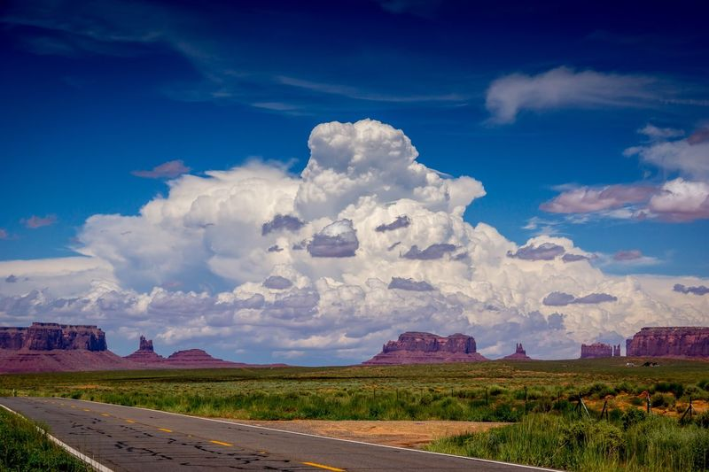 huge storm growing overhead monument valley Thunderstorm Sky Cloud - Sky Nationalpark Nature_collection Travel Destinations Travel USA Monument Valley Sky Landscape Environment Nature Land No People Travel Blue Outdoors