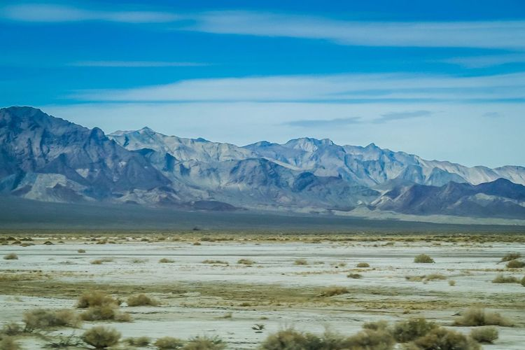 EyeEm Selects Death Valley National Park Mountain Scenics Nature Tranquil Scene Beauty In Nature Mountain Range Tranquility Landscape Sky Outdoors Remote Cloud - Sky Day Cold Temperature No People Winter Snow Physical Geography Blue Travel Destinations USA