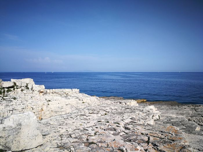 Sea Water Sky Blue Beauty In Nature Horizon Over Water Tranquility Horizon Sunny Clear Sky Landscape Rocks And Water Bluesea Travel Hiking Trail Istra Rt Kamenjak Outdoors No People Lovely Day Travel Destinations