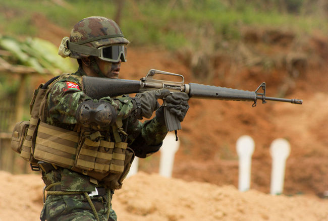 Unidentified A Soldier at Shan State in Myanmar Ssa Army EyeEmNewHere Aggression  Aiming Armed Forces Army Army Soldier Camouflage Clothing Day Fighting Focus On Foreground Government Gun Helmet Holding Land Machine Gun Military Military Uniform Outdoors People Rifle Security Special Forces Uniform Weapon