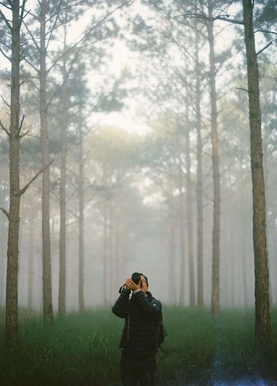 Mid Adult Man Photographing In Forest