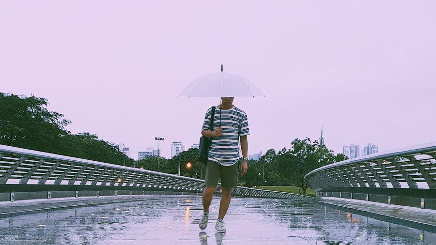 walk through the rain Full Length City Men Standing Rear View Protection Walking Sky Rainy Season RainDrop Rain