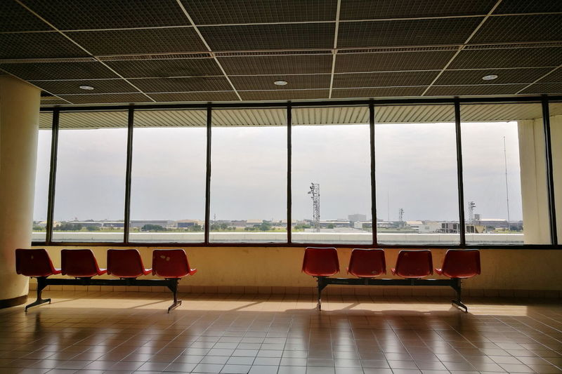 Empty chairs and tables in airport