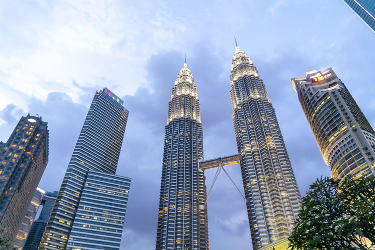 Sunset at Petronas Twin Towers KLCC, Kuala Lumpur Building Exterior Built Structure Architecture Office Building Exterior Building Skyscraper City Tall - High Sky Modern Low Angle View Tower Office Cloud - Sky Travel Destinations Nature Urban Skyline No People Landscape Cityscape Outdoors Financial District  Spire