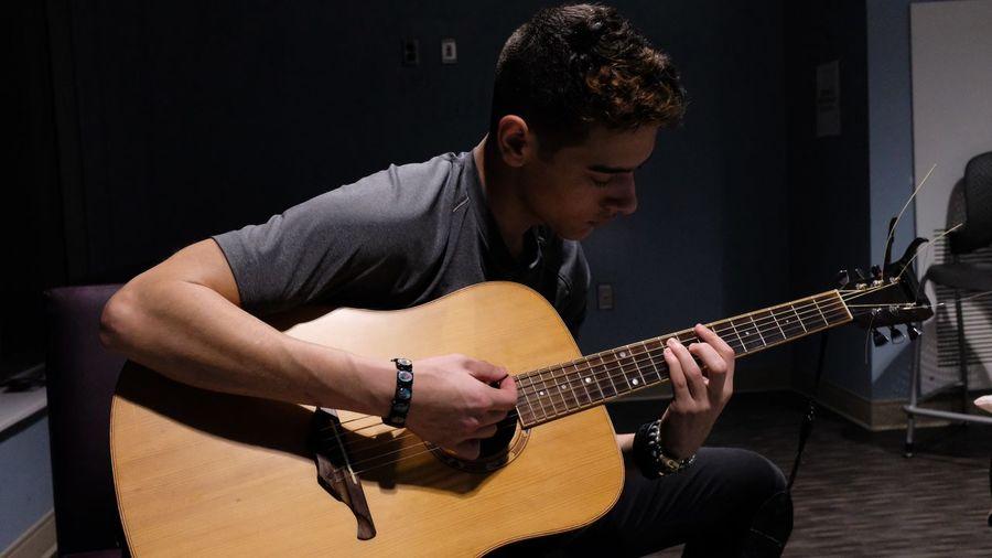 Young man playing guitar