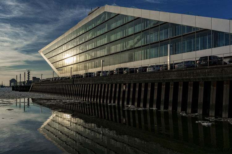 Dockland Afternoon Sunlight Cars Hamburg Harbour Kai Modern Architecture Nikon Water Reflections Wintertime Architecture Blue Sky Broken Ice On Frozen River Building Exterior Built Structure City Cloud - Sky Cooltime Day Elbe Glass March Modern Nikonphotography No People Outdoors Reflection Reflections River Sky Water Windows
