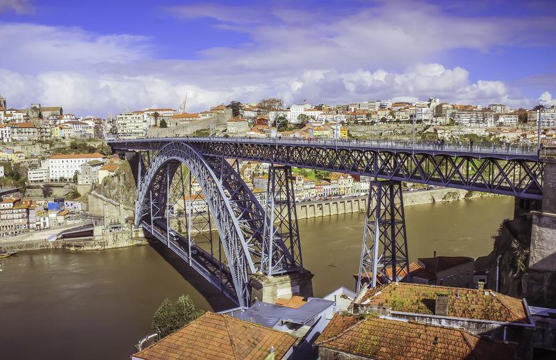 Bridge Over The River Douro  EyeEm Best Shots EyeEm Porto EyeEm Portugal Golden River Porto Arch Bridge Bridge Built Structure City Cloud - Sky Connection Day Douro River No People Outdoors River Water