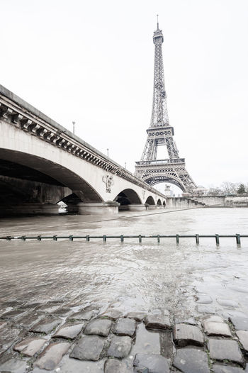 Tower Eiffle water flood in Paris, France Built Structure Architecture Sky Travel Destinations Tourism City Tower Travel History The Past Nature Bridge Bridge - Man Made Structure Building Exterior Water Tall - High Connection Day No People Arch Outdoors Arch Bridge Tower Eiffel Tower Eiffle Paris France Eiffel Tower Eiffel_tower  Flood Water Flood