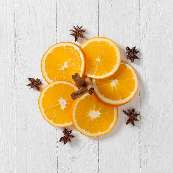 Litte arrangement of oranges, cinnamon rolls and star anise Anise Christmas Citrus Fruit Food Food And Drink Fruit High Angle View Indoors  No People Orange - Fruit SLICE Spice Star Anise Studio Shot Table Wood - Material EyeEmNewHere