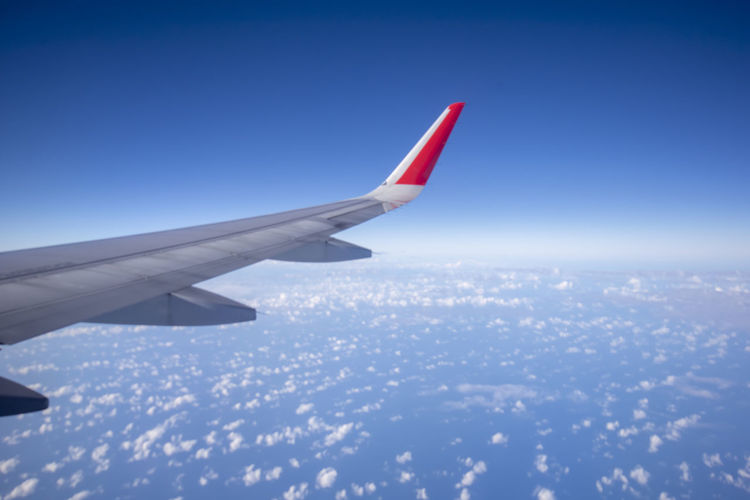 airplane wing Air Vehicle Airplane Flying Aircraft Wing Transportation Mode Of Transportation Sky Travel Nature No People Motion Journey Day Blue Mid-air Cloud - Sky on the move Outdoors Aerial View Aerospace Industry