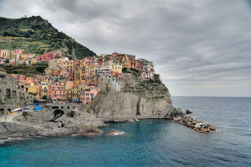 Architecture Beauty In Nature Built Structure Cinque Terre Cliff Cloud Cloud - Sky Cloudy Coastline Horizon Over Water Italy Italy❤️ Manarola Mountain Nature Outdoors Rock - Object Rock Formation Scenics Sea Sky Town TOWNSCAPE Travel Water