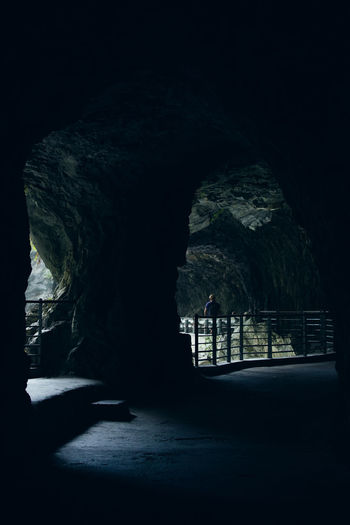 Silhouette of rock formation in cave