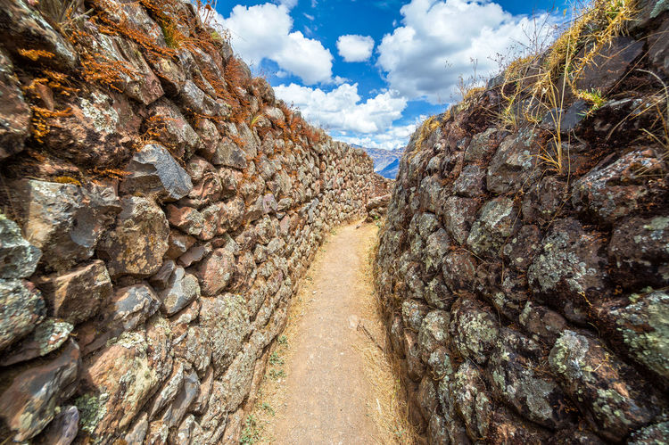 Narrow passage in the ruins of Pisac in the Sacred Valley near Cusco, Peru Ancient Andes Cusco Destination Famous Inca Landmark Landscape Lost Mountain Outdoors Peru Pisac Pisac Perú Ruin Ruins Sacred Valley Sacred Valley - Peru Stone Terrace Tourism Trail Travel Urubamba Valley