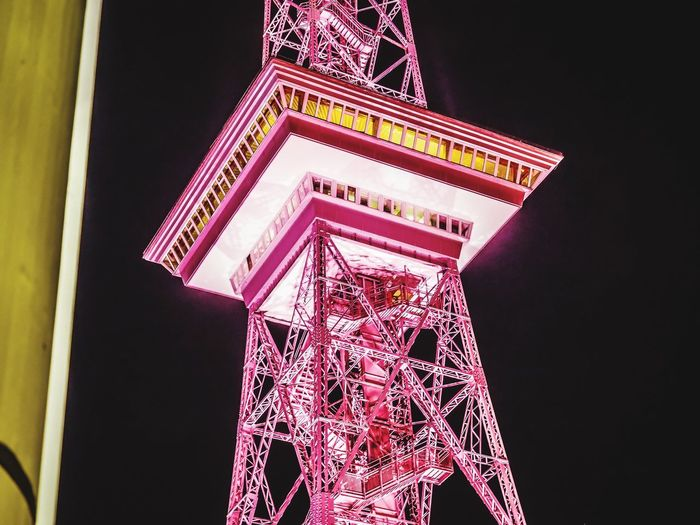 Pinkturm / Funkturm in pink Pretty In Pink Pink Color Pink Steel Stahlkonstruktion Stahl Berliner Funkturm Funkturm Berlin Funkturm TV Tower Low Angle View Built Structure Architecture Night Illuminated No People Building Exterior Tower Sky Lighting Equipment Building Pattern Travel Destinations Tall - High Tourism Glowing Outdoors