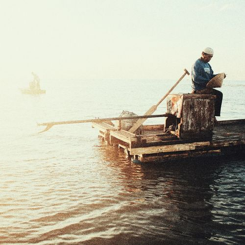 Real People Nature One Man Only Men Working Water One PersonNautical Vessel Fishing Net Outdoors Fisherman People Sea Day Occupation Oar Adult Rowing Adults Only Only Men First Eyeem Photo