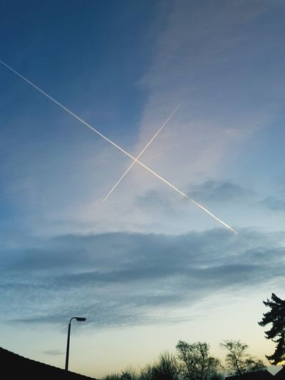 airplane tracks forming a cross An Eye For Travel Vapor Trail Sky Nature Blue Airplane Air Vehicle No People Clear Sky Airshow Outdoors Flying Scenics