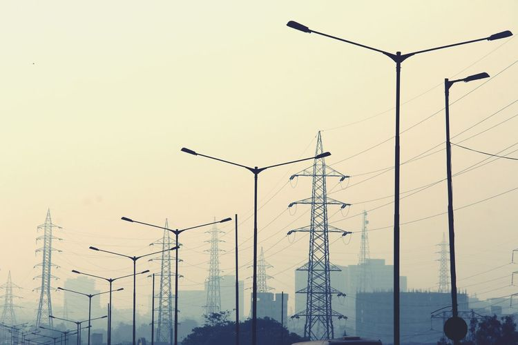 Street lights Towers Electric Grid Sunset Urban Skyline Urban Sky Sepia Cityscape Technology Electricity Pylon Electricity  Fuel And Power Generation Cable Industry Alternative Energy Power Supply Telephone Pole Tall - High