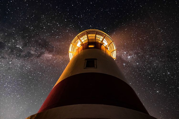 Architecture Astronomy Building Building Exterior Built Structure Galaxy Guidance Lighthouse Low Angle View Nature Night No People Outdoors Scenics - Nature Sky Space Space And Astronomy Star Star - Space Star Field Tower