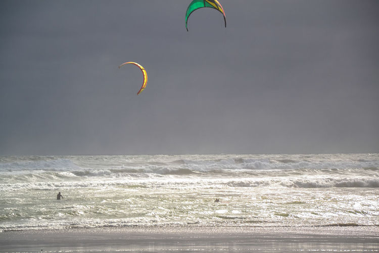 Kitsurfing Adventure Aquatic Sport Beach Extreme Sports Freedom Horizon Over Water Kiteboarding Kitsurf Leisure Activity Lifestyles Motion Nature One Person Outdoors Parachute People Sea Sky Sport Unrecognizable Person Water Watersports Wave Wind
