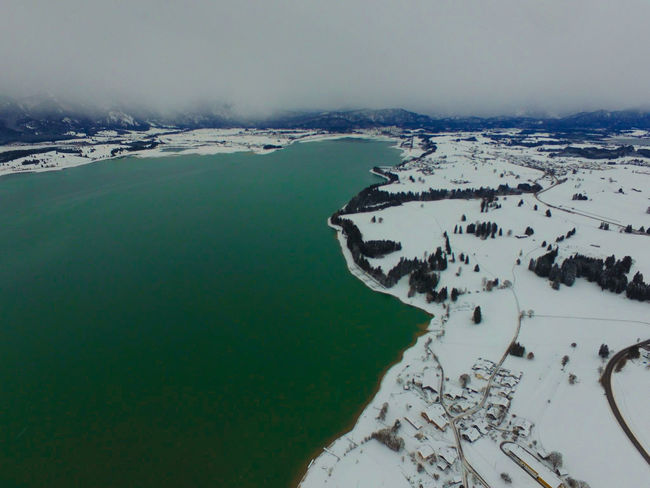 Forggensee from above. Shot with my DJI Phantom Snow Winter Winter Wonderland Alps Germany Allgaeu Bavaria Mountain View German Dji Dji Phantom Green Water Green Lake Lake View Lakeside Water Sea Outdoors Nature Scenics Landscape No People Winter Mountain Beauty In Nature Snow