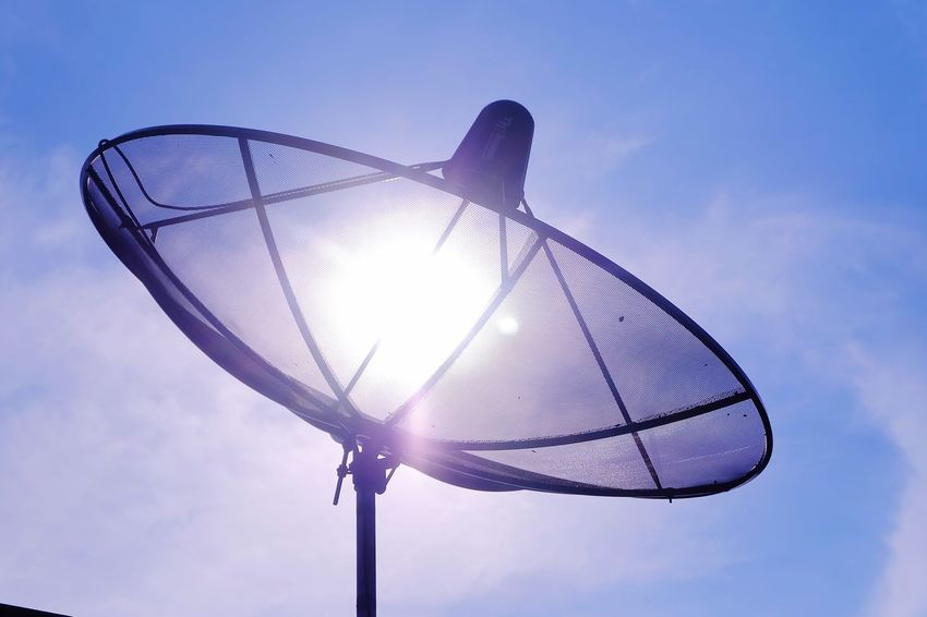satellite dish with bluesky Communication Sun Cloud Blue Sky Bluesky Satellite Dish Satellite Lens Flare Flare Sky No People Day Outdoors Technology Nature