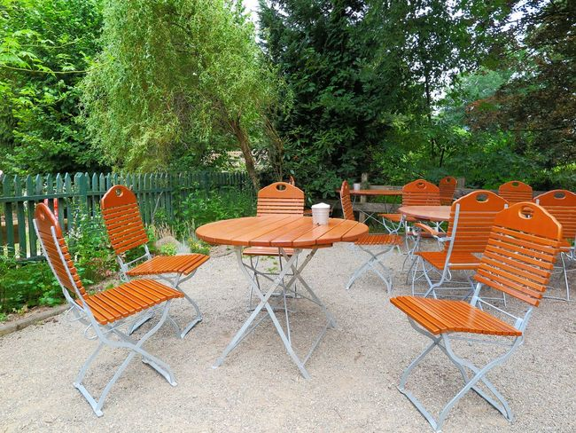 Biergarten Chair Day Empty Folding Chair Furniture Gravel Gravel Way Group Of Objects Nature No People Outdoor Cafe Outdoor Chair Outdoors Pebble Relaxation Rural Rural Scene Seat Seating Summer Table Tree Wooden