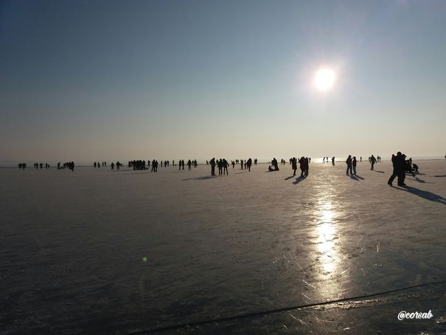 Magyarország Vonyarcvashegy Balaton Hungary Photography EyeEm Gallery People ❄️frozen❄️ Winter Outdoors Beach Large Group Of People Frozen Lake Samsungphotography Sunset Silhouette Silhuoette