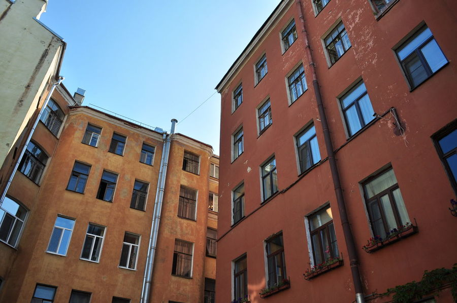 Apartment Architecture Building Building Exterior Built Structure City City Life Day Full Frame Low Angle View No People Outdoors Repetition Residential Building Residential Structure Sky Window